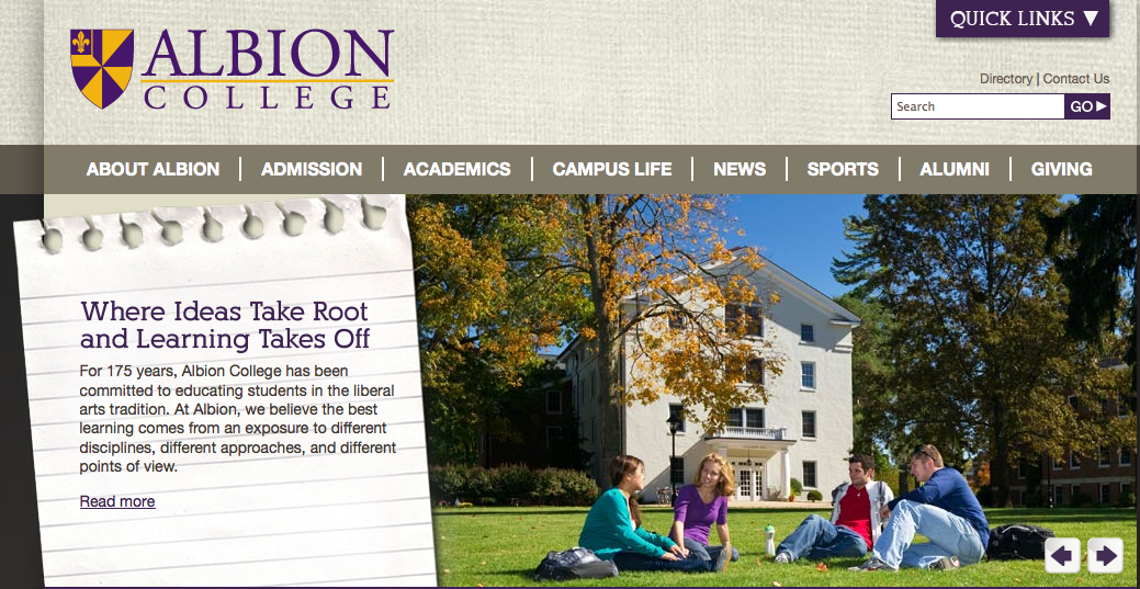 "Albion College homepage photo of students sitting outside on ""The Quad"""